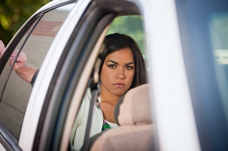 Young Woman Has Been Placed Into Custody In The Back Of A Police Cruiser. She Stares At The Viewer With Passionate, Icy Eye Contact. She Is Upset And Crying With Tears Very Evident.